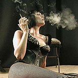 Fetish smoking  lascivious katja shows off her dominatrix outfit complete with cigarette. Excited katja shows off her mistress outfit complete with cigarette