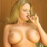 Great titty smoking  mojave rose shows off her great round tits while gulp on a cigar. Mojave Rose shows off her large round tits while blowjob on a cigar