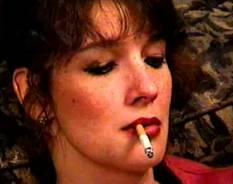 Hot older smoker  older babe jesse tries smoking her first cigar. Older babe Jesse tries smoking her first cigar