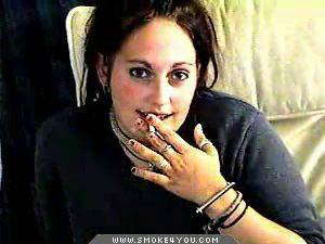 Goth smoking  curvy goth girl sits in her dorm room chainsmoking and listening to music. Busty Goth girl sits in her dorm room chainsmoking and listening to music