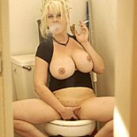 Super trashy  huge breasted white trash smokes like crazy on the toilet. Huge Breasted White trash smokes like crazy on the toilet